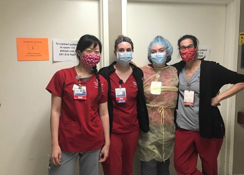 A Group of Four Nurses Standing in Front of Two Closed Doors